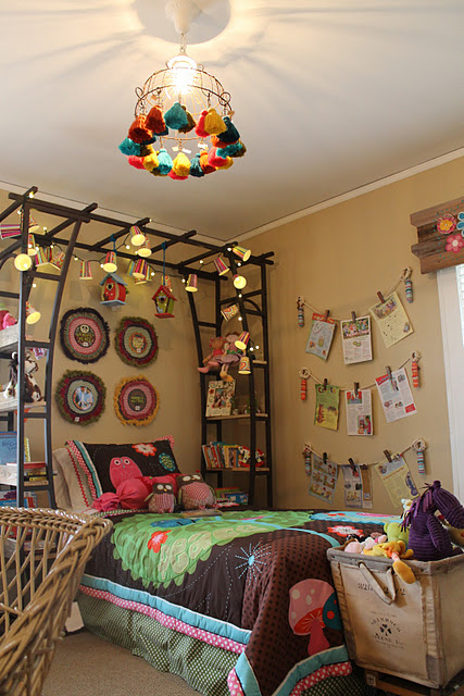 Canopy for a girl's bed made from a trellis.