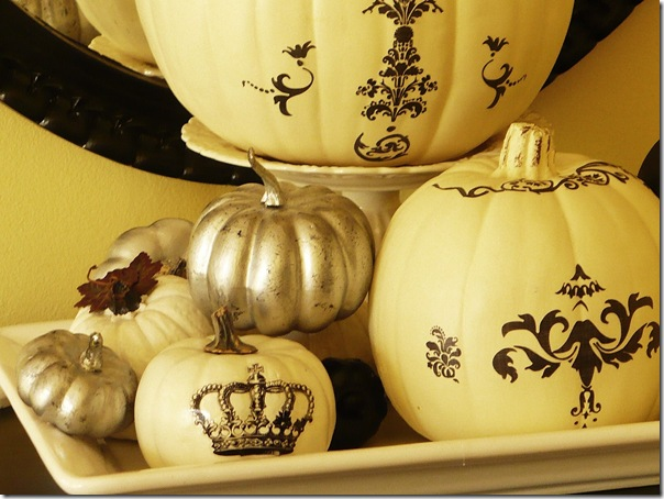 Decorated pumpkins with silver paint and rub on decals