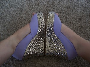 Shoes decorated with thumbtacks